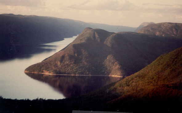 Mouse Head Hill on Grand lake (land locked fiord), south end, view to the North, lake arm around 5 km wide, hills some 500 m high.